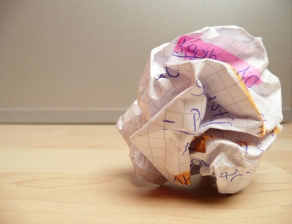 overcoming-writers-block-crumpled-paper-on-wooden-floor-photosteve101